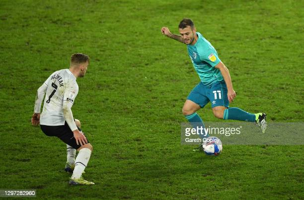 Jack Wilshere of AFC Bournemouth looks to break past Kamil Jozwiak of Derby County during the Sky Bet Championship match between Derby County and AFC...