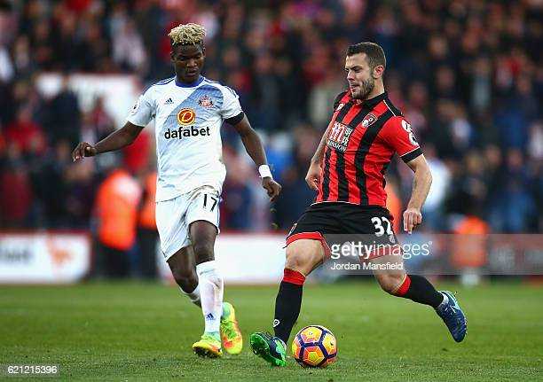 Jack Wilshere of AFC Bournemouth passes the ball past Dider Ndong of Sunderland during the Premier League match between AFC Bournemouth and...