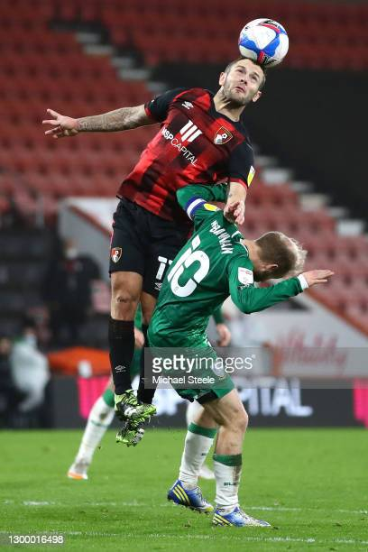 Jack Wilshere of AFC Bournemouth wins a header over Barry Bannan of Sheffield Wednesday during the Sky Bet Championship match between AFC Bournemouth...