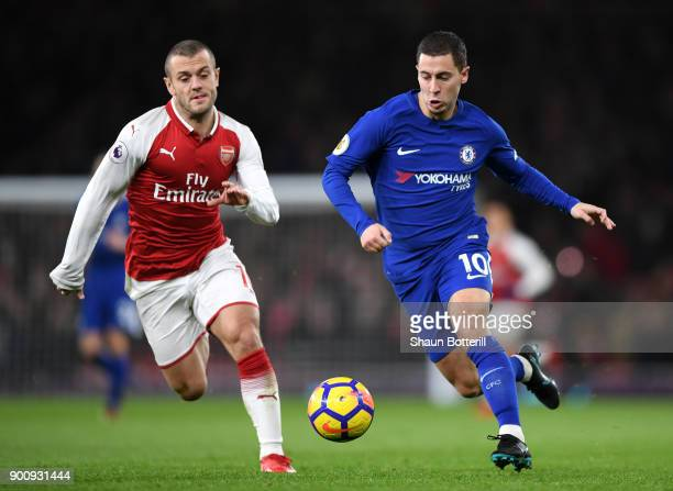 Jack Wilshere of Arsenal and Eden Hazard of Chelsea battle for possession during the Premier League match between Arsenal and Chelsea at Emirates...