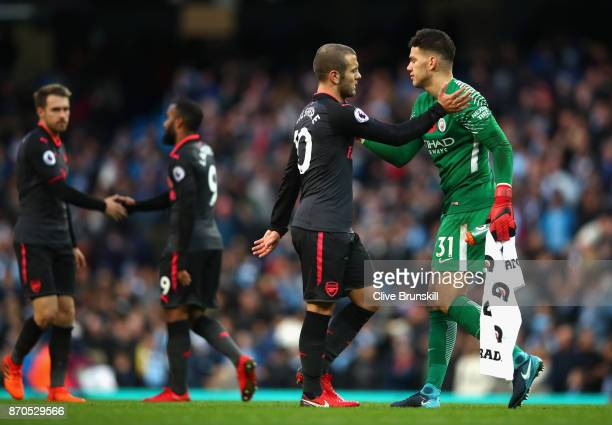 Jack Wilshere of Arsenal and Ederson of Manchester City embrace after the Premier League match between Manchester City and Arsenal at Etihad Stadium...