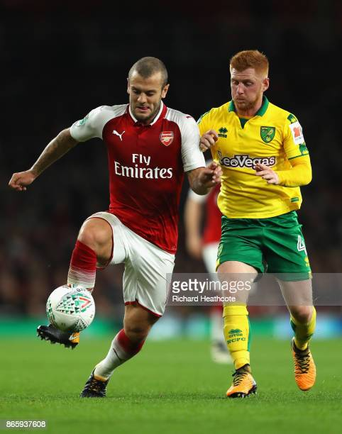 Jack Wilshere of Arsenal and Harrison Reed of Norwich City in action during the Carabao Cup Fourth Round match between Arsenal and Norwich City at...
