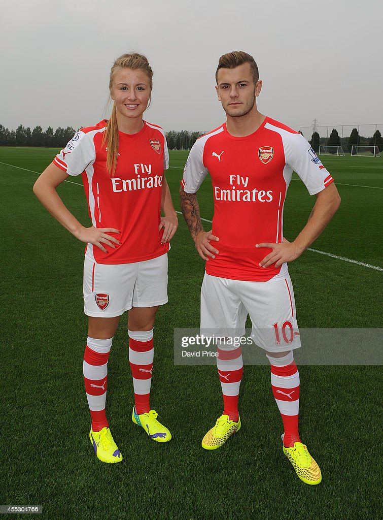 Jack Wilshere of Arsenal and Leah Williamson of Arsenal Ladies during the 1st team squad photograph at London Colney on September 11, 2014 in St Albans, England.