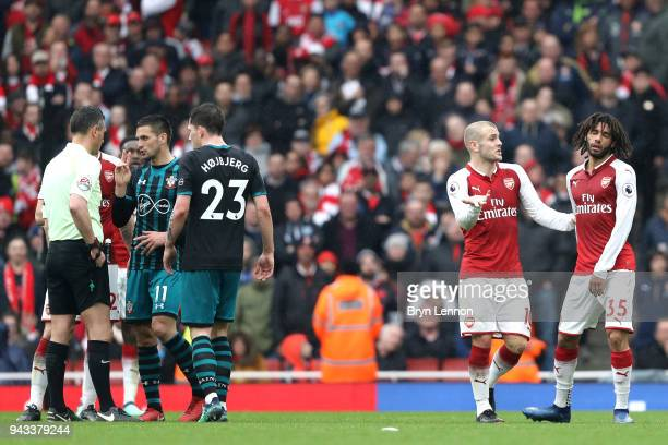 Jack Wilshere of Arsenal and Mohamed Elneny of Arsenal reacts after Mohamed Elneny is shown a red card during the Premier League match between...