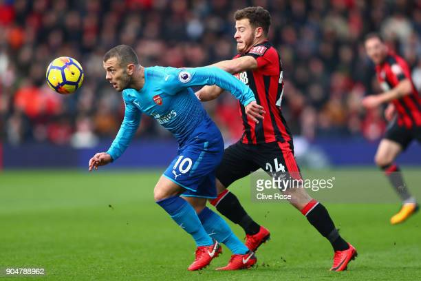Jack Wilshere of Arsenal and Ryan Fraser of AFC Bournemouth battles for possesion during the Premier League match between AFC Bournemouth and Arsenal...