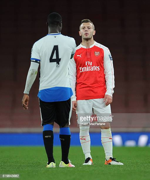Jack Wilshere of Arsenal argues with Newcastle's Henri Saivet during the Barclays Premier League match between Arsenal and Newcastle United at...