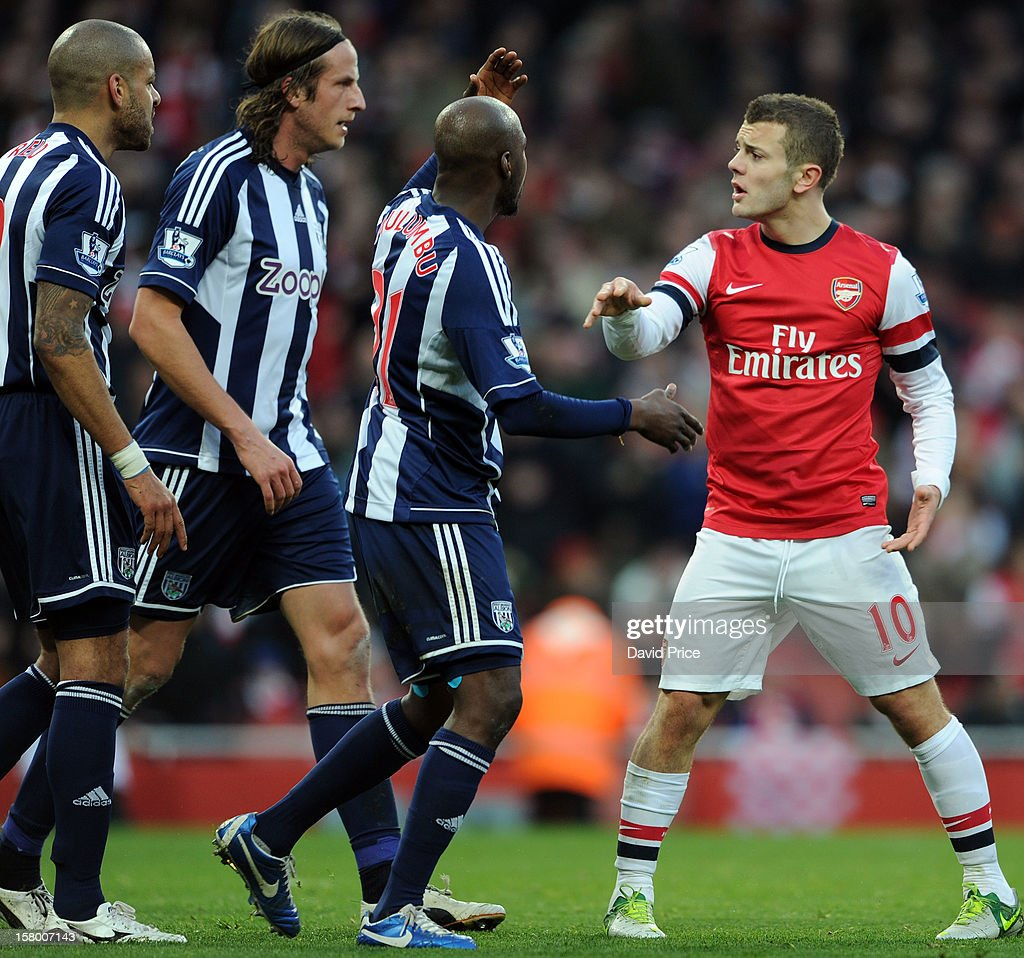 Jack Wilshere of Arsenal argues with Steven Reid, Jonas Olsson and Youssouf Mulumbu of WBA during the Barclays Premier League match between Arsenal and West Bromwich Albion, at Emirates Stadium on December 08, 2012 in London, England.
