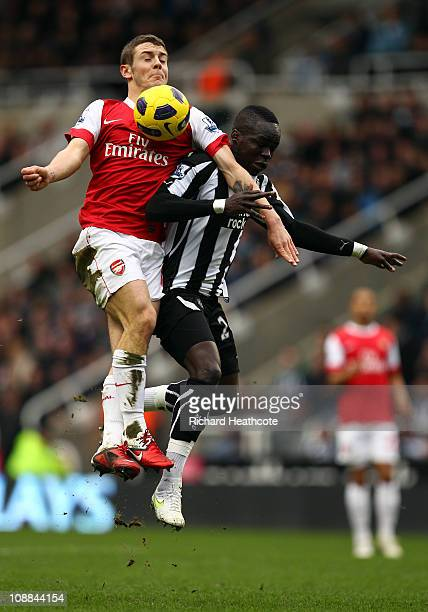 Jack Wilshere of Arsenal battles with Cheik Tiote of Newcastle during the Barclays Premier League match between Newcastle United and Arsenal at St...
