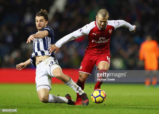 Jack Wilshere of Arsenal battles with Jay Rodriguez of West Bromwich Albion during the Premier League match between West Bromwich Albion and Arsenal...