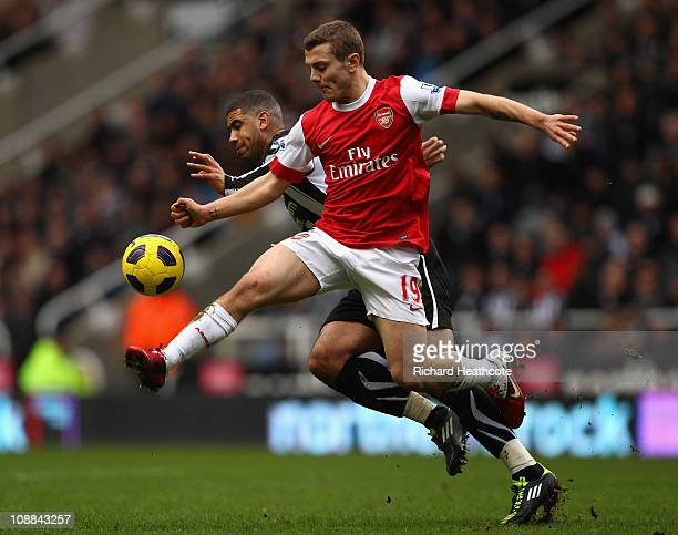 Jack Wilshere of Arsenal battles with Leon Best of Newcastle during the Barclays Premier League match between Newcastle United and Arsenal at St...