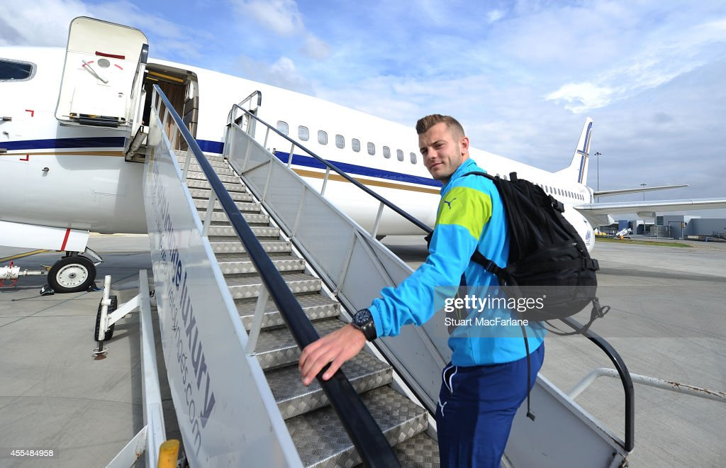 Jack Wilshere of Arsenal boards the team plane at Luton Airport on September 15, 2014 in St Albans, England. Photo by Stuart MacFarlane/Arsenal FC via Getty Images)