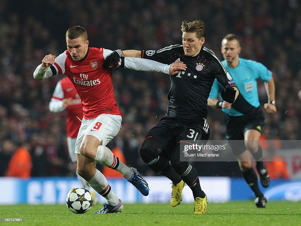 Jack Wilshere of Arsenal breaks past Bastian Schweinstiger of Bayern Munich during the UEFA Champions League Round of 16 first leg match between Arsenal FC and Bayern Muenchen at Emirates Stadium on February 19, 2013 in London, England.