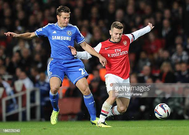 Jack Wilshere of Arsenal breaks past Cesar Azpilicueta of Chelsea during the match at Emirates Stadium on October 29 2013 in London England
