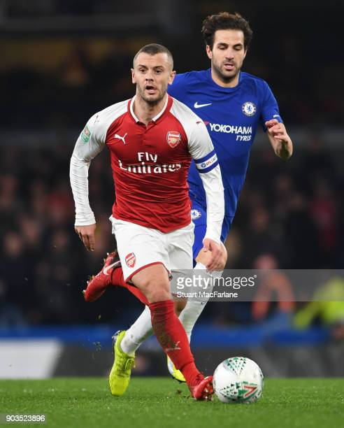 Jack Wilshere of Arsenal breaks past Cesc Fabregas of Arsenal during the Carabao Cup SemiFinal First Leg match between Chelsea and Arsenal at...