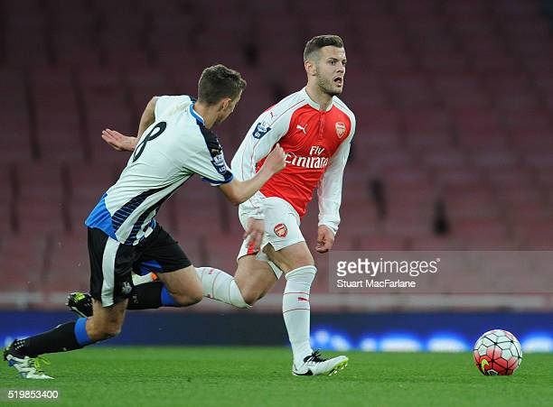 Jack Wilshere of Arsenal breaks past Dan Barlaser of Newcastle during the Barclays Premier League match between Arsenal and Newcastle United at...