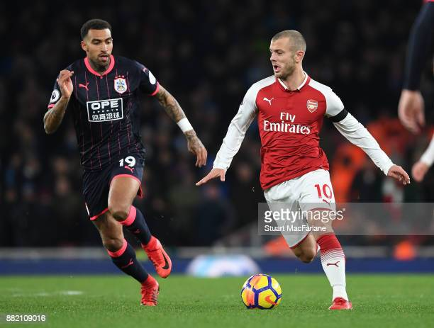 Jack Wilshere of Arsenal breaks past Danny Williams of Huddersfield during the Premier League match between Arsenal and Huddersfield Town at Emirates...