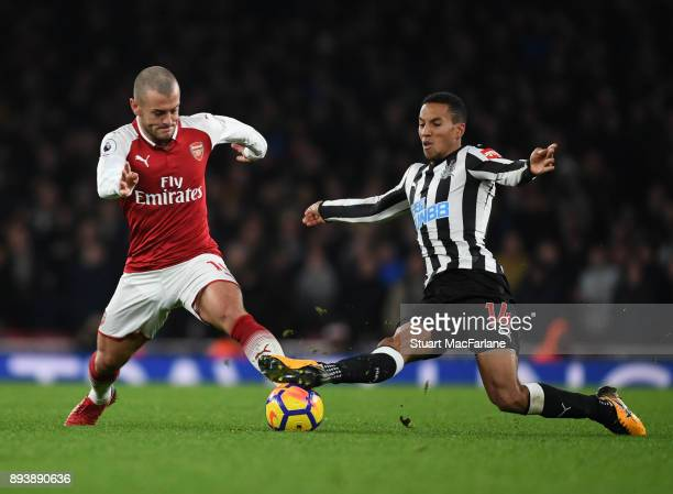 Jack Wilshere of Arsenal breaks past Issac Hayden of Newcastle during the Premier League match between Arsenal and Newcastle United at Emirates...