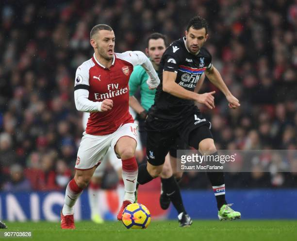 Jack Wilshere of Arsenal breaks past Luca Milivojevic of Crystal Palace during the Premier League match between Arsenal and Crystal Palace at...