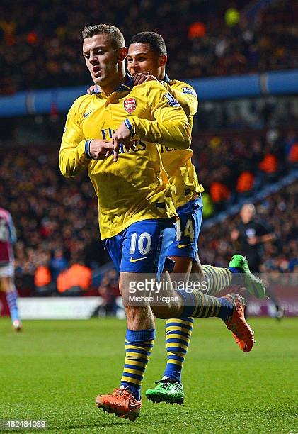 Jack Wilshere of Arsenal ceelbrates scoring the opening goal with Serge Gnabry of Arsenal during the Barclays Premier League match between Aston...