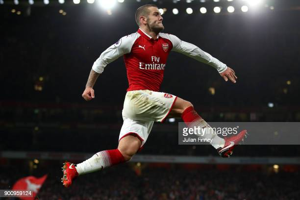 Jack Wilshere of Arsenal celebrates after scoring his sides first goal during the Premier League match between Arsenal and Chelsea at Emirates...