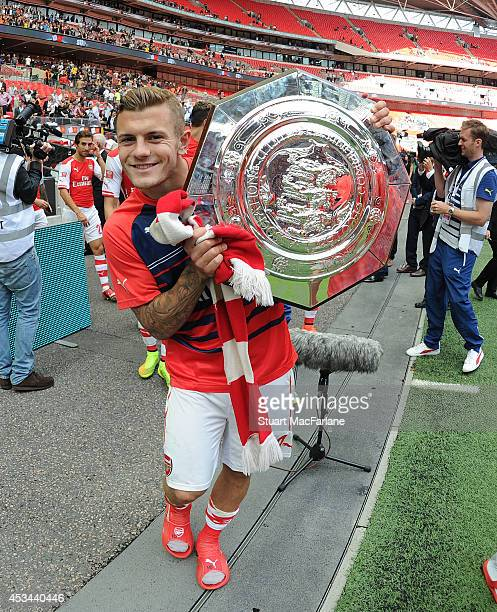 Jack Wilshere of Arsenal celebrates after the FA Community Shield match between Arsenal and Manchester City at Wembley Stadium on August 10 2014 in...