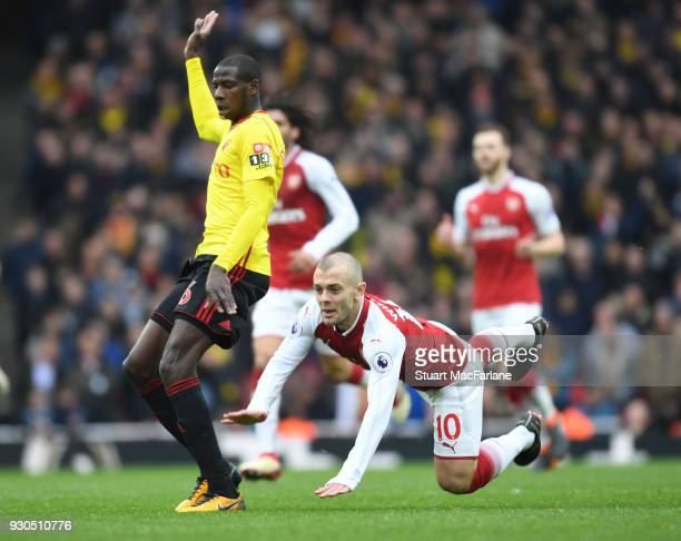 Jack Wilshere of Arsenal challenged by Abdoulaye Doucoure of Watford during the Premier League match between Arsenal and Watford at Emirates Stadium...