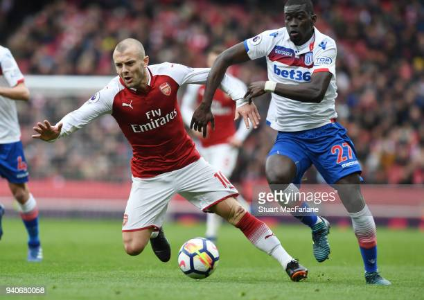 Jack Wilshere of Arsenal challenged by Badou Ndiaye of Stoke during the Premier League match between Arsenal and Stoke City at Emirates Stadium on...