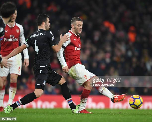 Jack Wilshere of Arsenal challenged by Luka Milivojevic of Crystal Palace during the Premier League match between Arsenal and Crystal Palace at...
