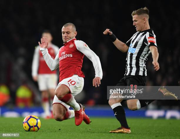 Jack Wilshere of Arsenal challenged by Matt Ritchie of Newcastle during the Premier League match between Arsenal and Newcastle United at Emirates...