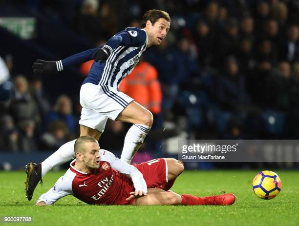 Jack Wilshere of Arsenal challenges Grzegorz Krychowiak of WBA during the Premier League match between West Bromwich Albion and Arsenal at The...