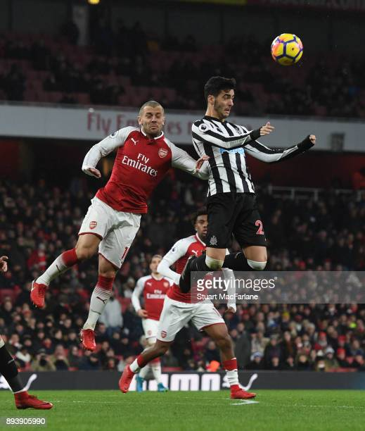 Jack Wilshere of Arsenal challenges Mile Merino of Newcastle during the Premier League match between Arsenal and Newcastle United at Emirates Stadium...