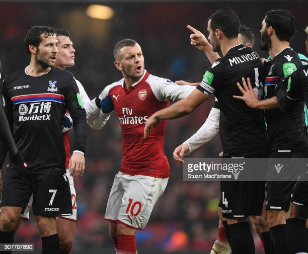 Jack Wilshere of Arsenal clashes with Luca Milivojevic of Crystal Palace during the Premier League match between Arsenal and Crystal Palace at...