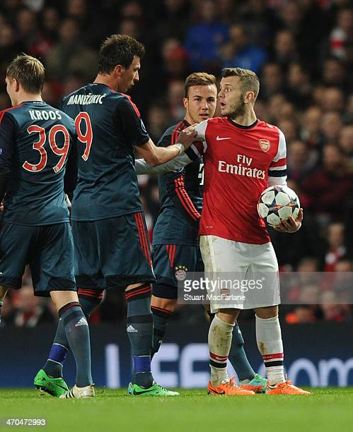 Jack Wilshere of Arsenal clashes with Mario Mandzukic of Bayern Munich during the UEFA Champions League match between Arsenal and FC Bayern Muenchen...