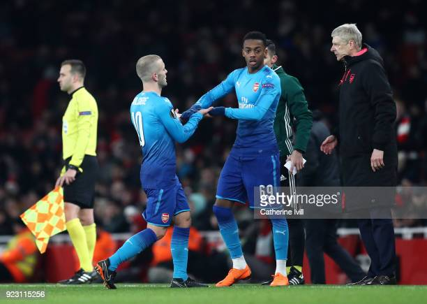 Jack Wilshere of Arsenal comes off for Joseph Willock of Arsenal during UEFA Europa League Round of 32 match between Arsenal and Ostersunds FK at the...