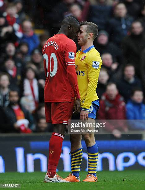 Jack Wilshere of Arsenal confronts Aly Cissokho of Liverpool during the Barclays Premier League match between Liverpool and Arsenal at Anfield on...
