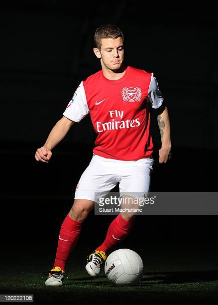 Jack Wilshere of Arsenal FC poses in the Arsenal home kit for the 2011/2012 season at their London Colney training ground on April 8 2011 in St...