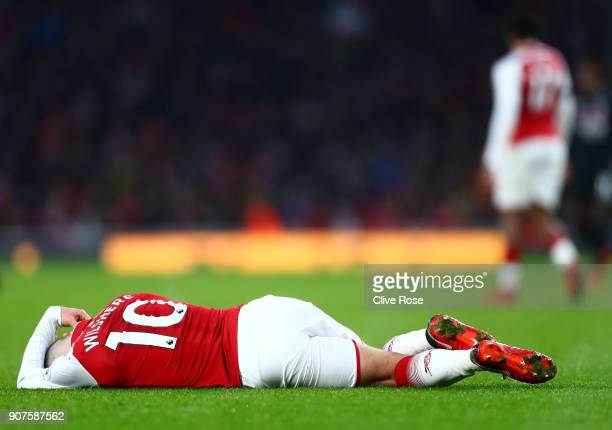 Jack Wilshere of Arsenal goes down holding his head during the Premier League match between Arsenal and Crystal Palace at Emirates Stadium on January...