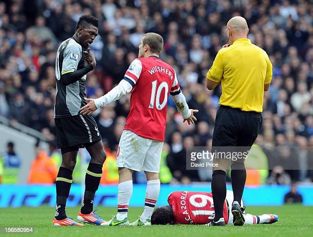 Jack Wilshere of Arsenal has a word with Emmanuel Adebayor of Tottenham after his foul on Santi Cazorla during the Barclays Premier League match...
