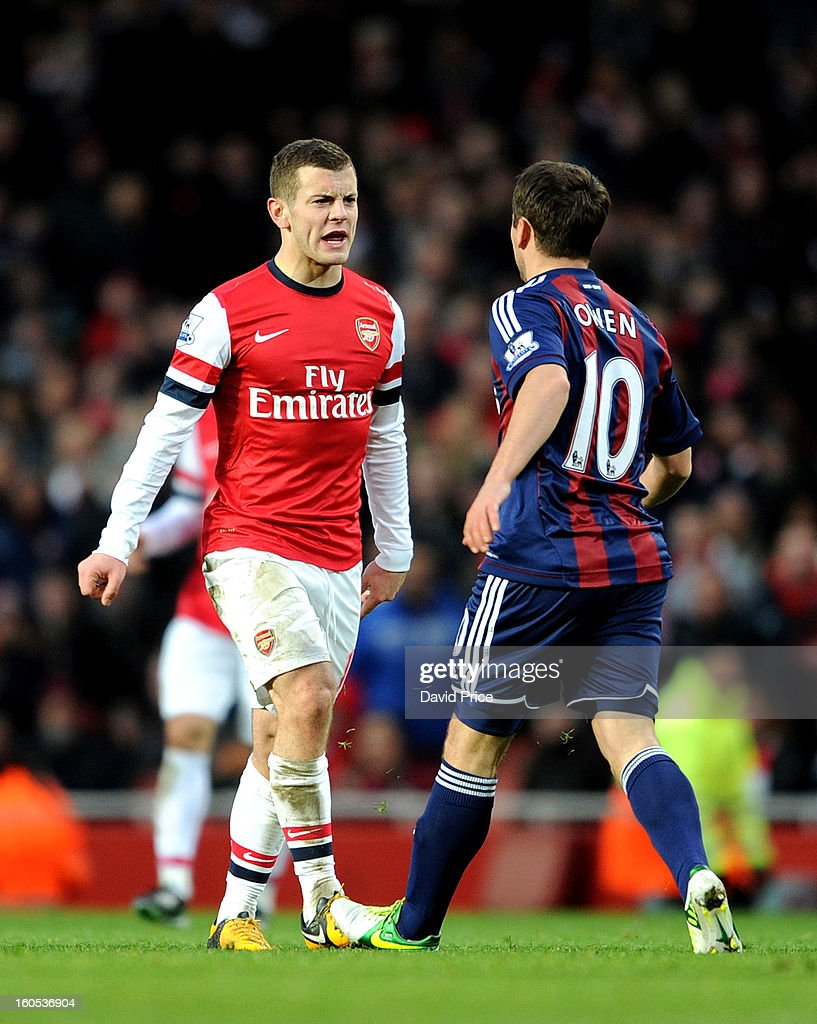 Jack Wilshere of Arsenal has words with Michael Owen of Stoke during the Barclays Premier League match between Arsenal and Stoke City at Emirates Stadium on February 02, 2013 in London, England.