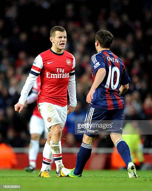 Jack Wilshere of Arsenal has words with Michael Owen of Stoke during the Barclays Premier League match between Arsenal and Stoke City at Emirates...
