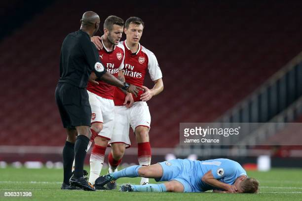 Jack Wilshere of Arsenal headbuts Matthew Smith of Manchester City and is later sent off during the Premier League 2 match between Arsenal v...