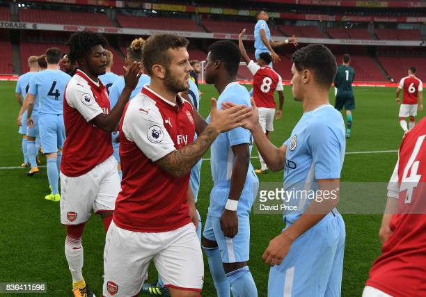 Jack Wilshere of Arsenal high fives of Brahim Diaz of Manchester City before the match between Arsenal U23 and Manchester City U23 at Emirates...
