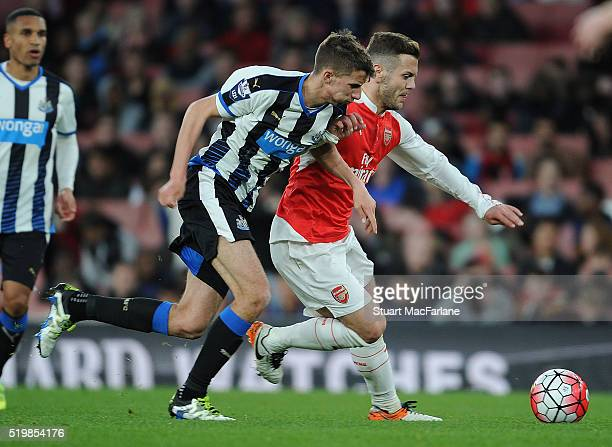 Jack Wilshere of Arsenal holds off Luke Charman of Newcastle during the Barclays Premier League match between Arsenal and Newcastle United at...