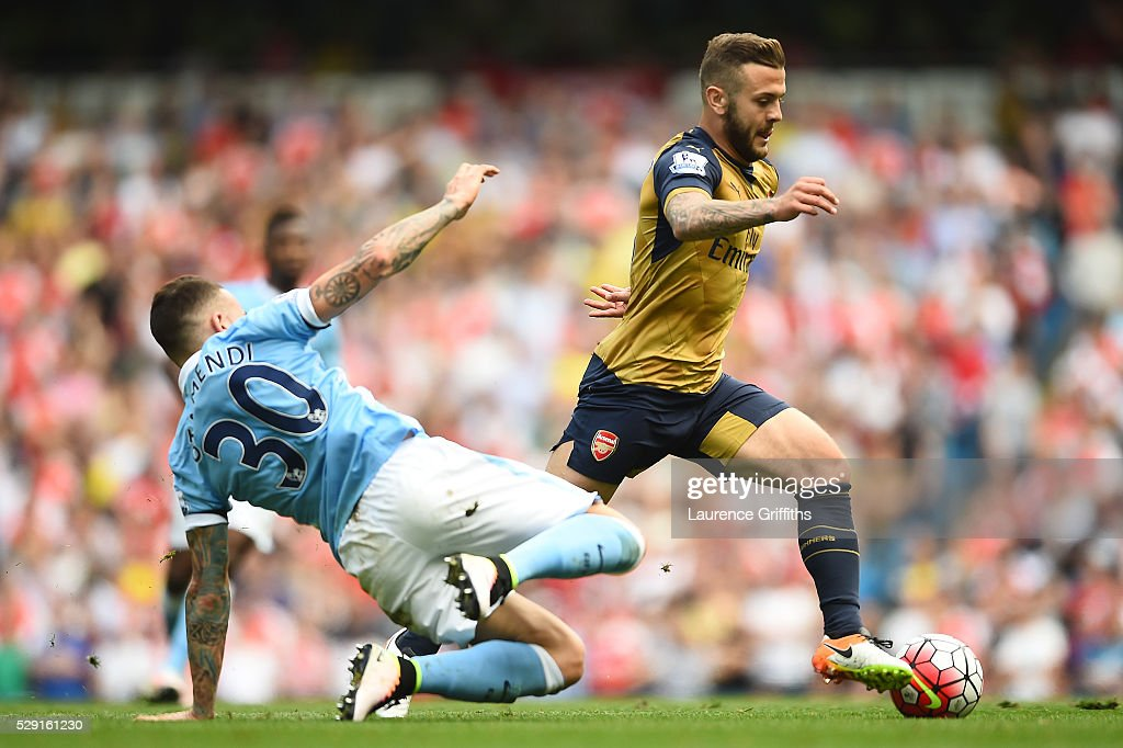 Jack Wilshere of Arsenal holds off Nicolas Otamendi of Manchester City during the Barclays Premier League match between Manchester City and Arsenal at the Etihad Stadium on May 8, 2016 in Manchester, England.