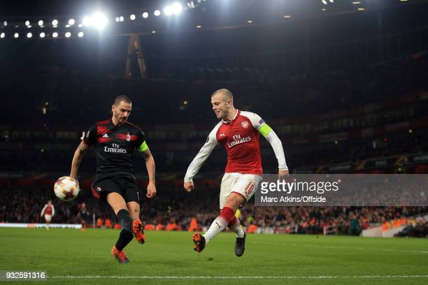 Jack Wilshere of Arsenal in action with Leonardo Bonucci of AC Milan during the UEFA Europa League Round of 16 2nd leg match between Arsenal and AC...