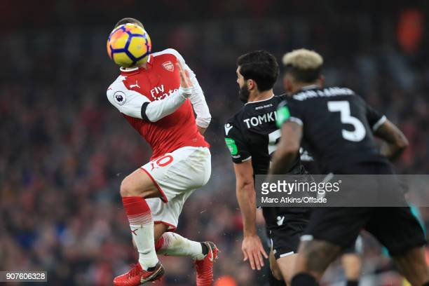 Jack Wilshere of Arsenal in action with Patrick van Aanholt and James Tomkins of Crystal Palace during the Premier League match between Arsenal and...