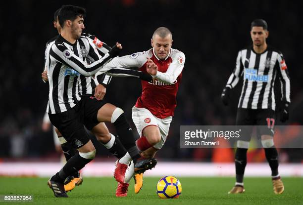 Jack Wilshere of Arsenal is challenged by Mikel Merino of Newcastle United during the Premier League match between Arsenal and Newcastle United at...