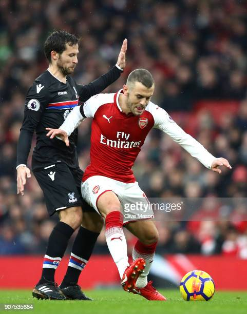 Jack Wilshere of Arsenal is challenged by Yohan Cabaye of Crystal Palace during the Premier League match between Arsenal and Crystal Palace at...
