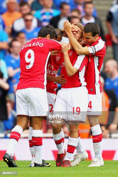 Jack Wilshere of Arsenal is congratulated by teammates after scoring the opening goal during the Emirates Cup match between Arsenal and Glasgow...