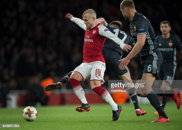 Jack Wilshere of Arsenal is tackled by Aleksandr Golovin of CSKA Moscow during the UEFA Europa League Quarter final 1st Leg match between Arsenal and...